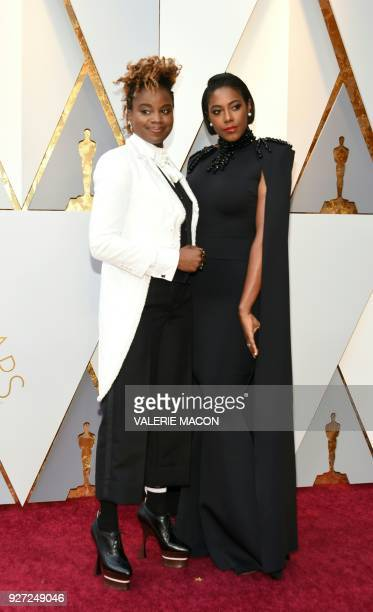Dee Rees and Sarah Broom arrive for the 90th Annual Academy Awards on March 4 in Hollywood California / AFP PHOTO / VALERIE MACON