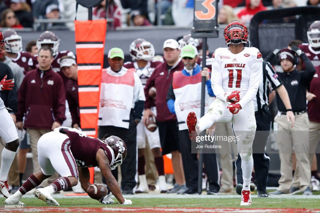 Dee Smith #11 of the Louisville Cardinals reacts after making a tackle for loss in the first half of the TaxSlayer Bowl against the Mississippi State Bulldogs at EverBank Field on December 30, 2017 in Jacksonville, Florida.
