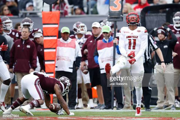 Dee Smith of the Louisville Cardinals reacts after making a tackle for loss in the first half of the TaxSlayer Bowl against the Mississippi State...