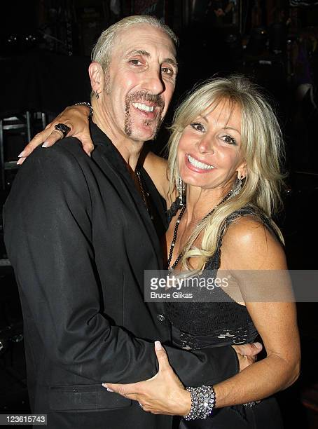Dee Snider and wife Suzette Snider pose backstage at The hit Rock Musical Rock of Ages at the Brooks Atkinson Theatre on October 11 2010 in New York...