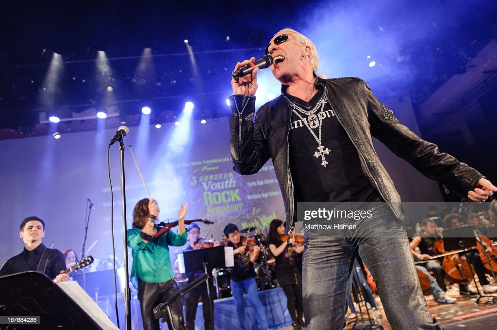 Dee Snider of the band Twisted Sister performs live with The 5-Borough Youth Rock Symphony at the Electrify Your Music Foundation launch event at Brooklyn Technical High School Theater on April 26, 2013 in the Brooklyn borough of New York City.