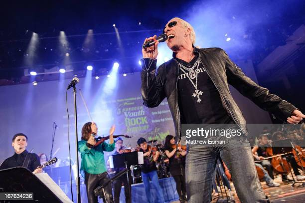 Dee Snider of the band Twisted Sister performs live with The 5Borough Youth Rock Symphony at the Electrify Your Music Foundation launch event at...