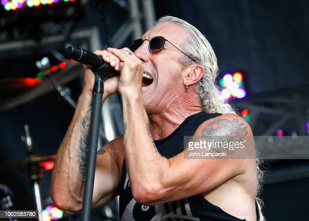 Fox News anchors Janice Dean Jillian Mele and Steve Doocy stand on stage with Dee Snider before he performs on 'FOX Friends' on July 20 2018 in New...