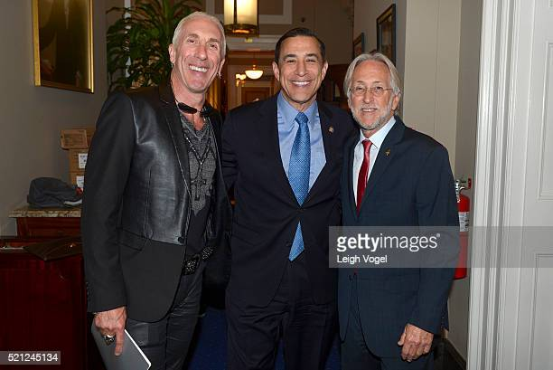 Dee Snider Representative Darrell Issa and Neil Portnow pose for a photo during GRAMMYs on the Hill Advocacy Day on Capitol Hill on April 14 2016 in...