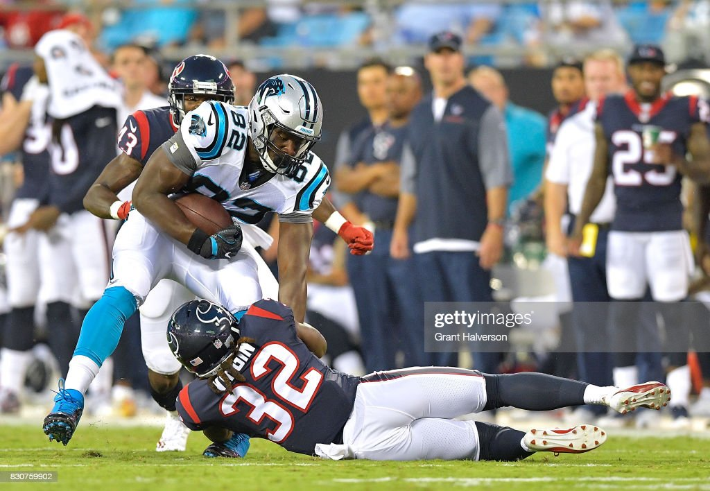 Dee Virgin #32 of the Houston Texans tackles Chris Manhertz #82 of the Carolina Panthers during their game at Bank of America Stadium on August 9, 2017 in Charlotte, North Carolina.