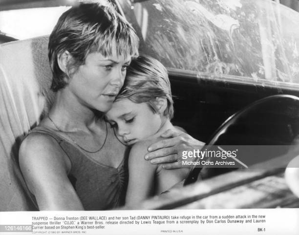 Dee Wallace holds her son Danny Pintauro in a scene from the film 'Cujo' 1983