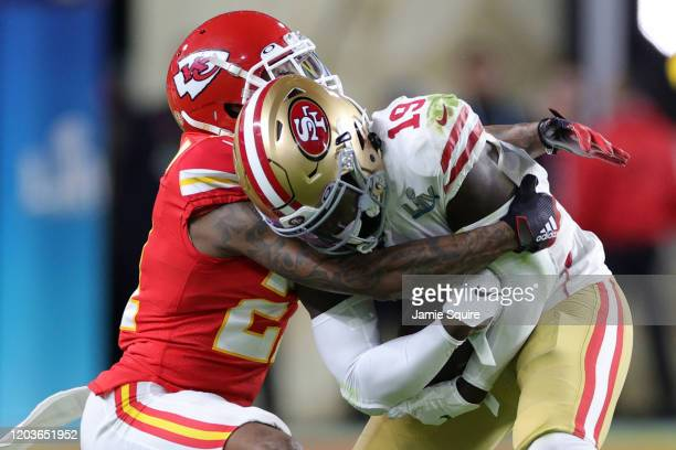 Deebo Samuel of the San Francisco 49ers is tackled by Bashaud Breeland of the Kansas City Chiefs in Super Bowl LIV at Hard Rock Stadium on February...