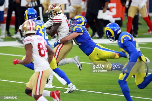 Deebo Samuel of the San Francisco 49ers is tackled by Troy Reeder of the Los Angeles Rams during the fourth quarter at SoFi Stadium on November 29,...