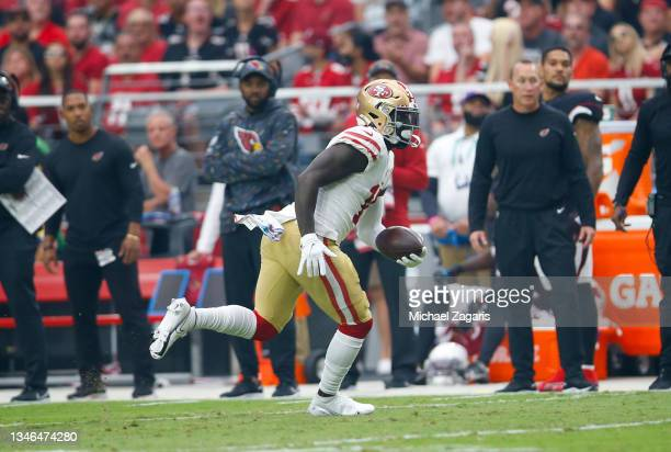 Deebo Samuel of the San Francisco 49ers runs after making a catch during the game against the Arizona Cardinals at State Farm Stadium on October 10,...