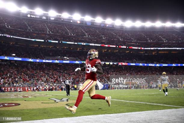 Deebo Samuel of the San Francisco 49ers runs in for a touchdown against the Green Bay Packers at Levi's Stadium on November 24, 2019 in Santa Clara,...