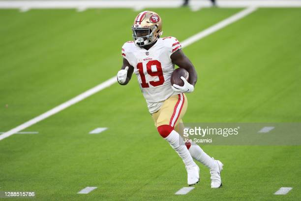 Deebo Samuel of the San Francisco 49ers runs with the ball during the second half against the Los Angeles Rams at SoFi Stadium on November 29, 2020...