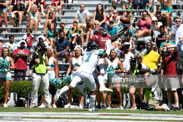Deebo Samuel of the South Carolina Gamecocks catches the ball for a eightyard touchdown against Mallory Claybourne of the Coastal Carolina...