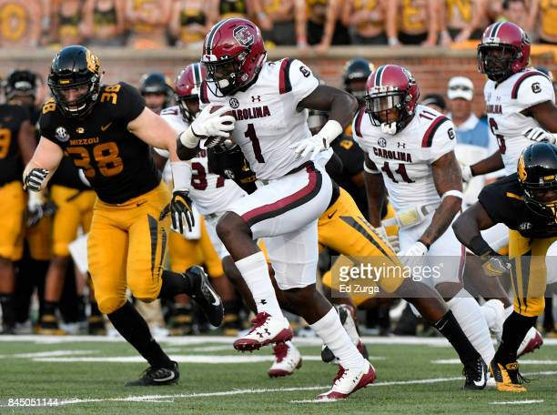Deebo Samuel of the South Carolina Gamecocks returns a kick for a 97yard touchdown against the Missouri Tigers in the second quarter at Memorial...