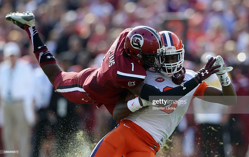 Deebo Samuel #1 of the South Carolina Gamecocks tackles Deon Cain #8 of the Clemson Tigers during their game at Williams-Brice Stadium on November 28, 2015 in Columbia, South Carolina.
