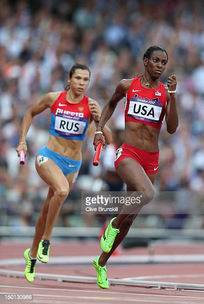 DeeDee Trotter of the United States and Anastasiya Kapachinskaya of Russia compete during the Women's 4 x 400m Relay Round 1 heats on Day 14 of the...