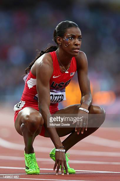 DeeDee Trotter of the United States looks to the scoreboard after competing in the Women's 400m Semi Final on Day 8 of the London 2012 Olympic Games...