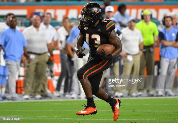 DeeJay Dallas of the Miami Hurricanes runs with the ball against the North Carolina Tar Heels at Hard Rock Stadium on September 27 2018 in Miami...