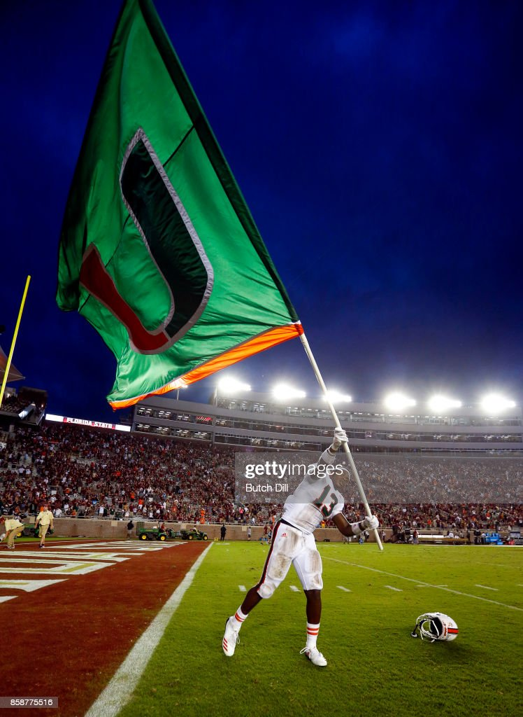 DeeJay Dallas #13 of the Miami Hurricanes waves the flag after they defeated the Florida State Seminoles 24-20 during the second half of an NCAA football game at Doak S. Campbell Stadium on October 7, 2017 in Tallahassee, Florida.