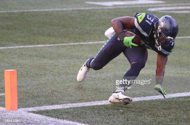 DeeJay Dallas of the Seattle Seahawks scores a touchdown against the San Francisco 49ers in the third quarter of the game at CenturyLink Field on...