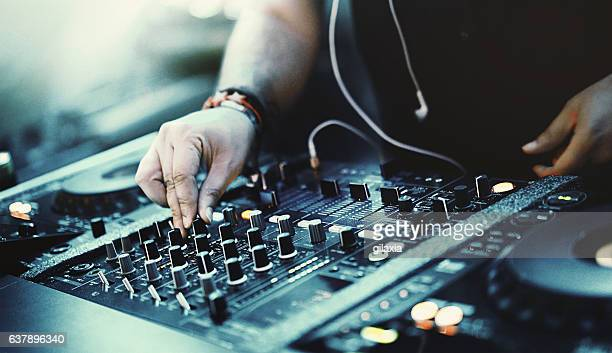 Deejay playing music at a party.
