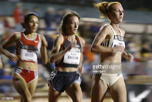 Deena Drossin passes Katie McGregor in the women's 10k finals during the USA Outdoor Track and Field Championships on June 19, 2003 at Cobb Track and...