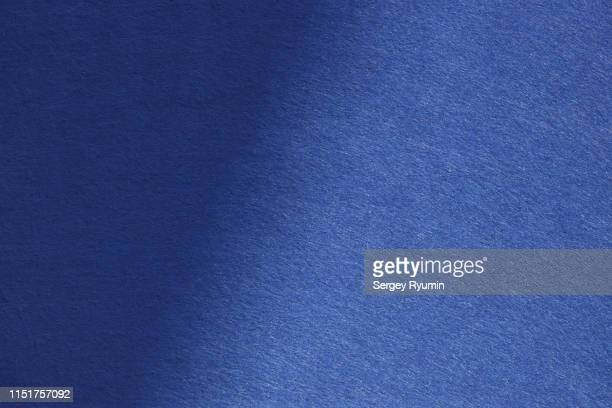 deep blue felt with shadow - velvet stock photos and pictures
