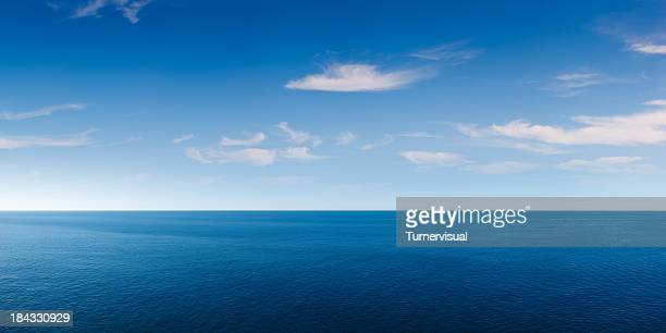 deep blue ocean panorama - sky stock pictures, royalty-free photos & images