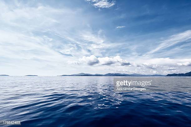 deep blue ocean - dramatic sky stock pictures, royalty-free photos & images