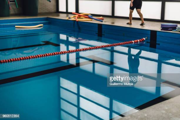 Deep Blue Swimming Pool Reflections and Silhouette