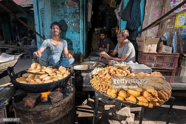 Deep fried snacks like Samosa are prepared in a small street of the old walled Pink City