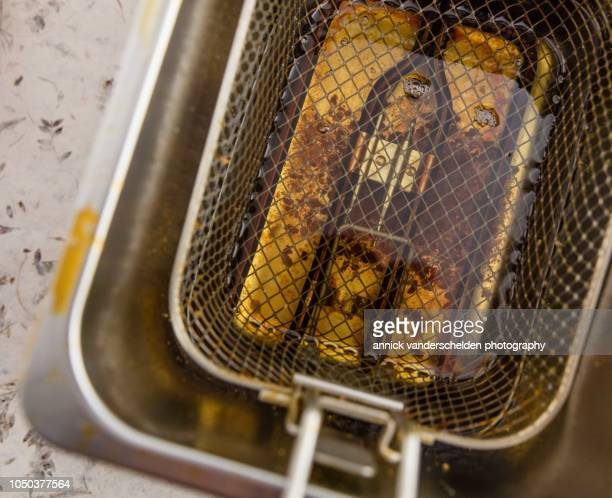deep fryer with oil - deep fried stock pictures, royalty-free photos & images