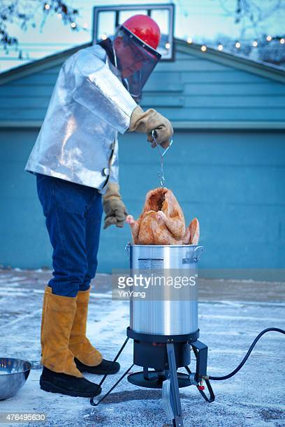 deep frying turkey in hot oil for christmas and thanksgiving - breaded stock photos and pictures