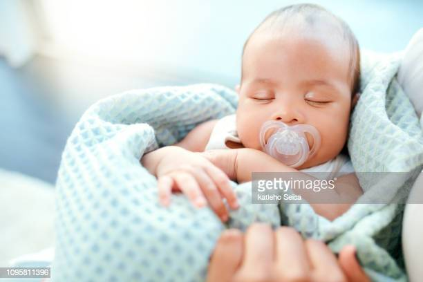 deep in dreamland - pacifier stock pictures, royalty-free photos & images