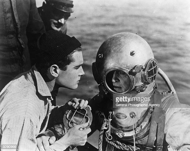 A deep sea diver emerges from the depths in a scene from the silent film 'Below The Surface'