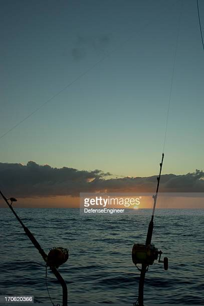 deep sea fishing at dawn - big game fishing stock photos and pictures