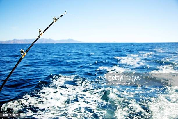 deep sea fishing pole - big game fishing stock photos and pictures