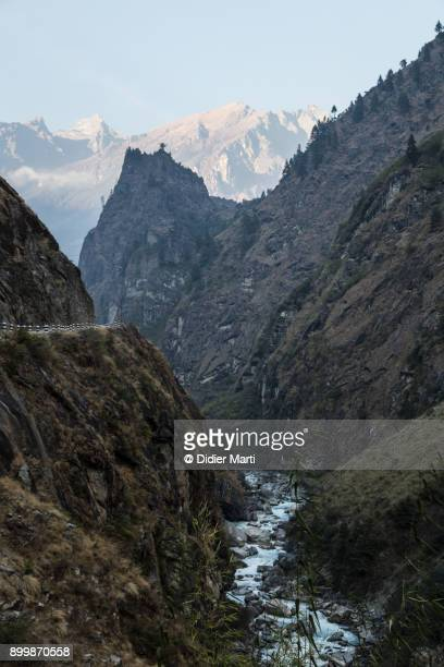 deep valley at sunset in the annapurna mountain range along the famous annapurna circuit trekking in nepal - annapurna circuit stock photos and pictures