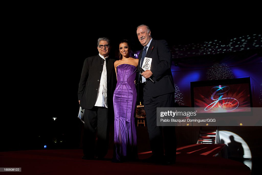 Deepack Chopra (L) Eva Longoria (C) and Vicenter del Bosque (R) stand on stage during the Global Gift Gala held to raise benefits for Cesare Scariolo Foundation and Eva Longoria Foundation on August 19, 2012 in Marbella, Spain.