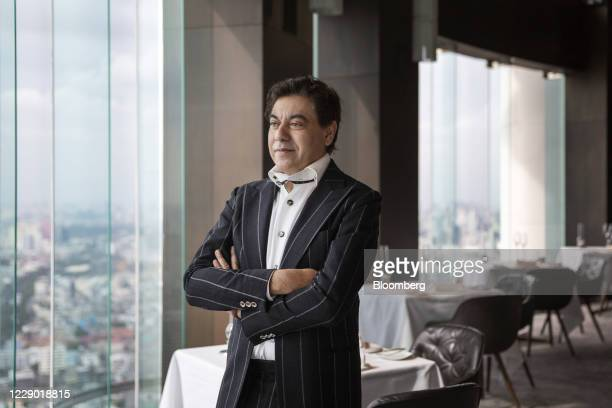 Deepak Ohri chief executive officer of Lebua Hotels Resorts Co stands for a portrait at the Mezzaluna restaurant in the Lebua at State Tower hotel in...