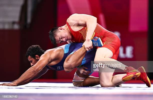 Deepak Punia of India competes against Lin Zushen of China during the Men's Freestyle 86kg 1/4 Final on day twelve of the Tokyo 2020 Olympic Games at...