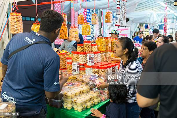 deepavali bazaar in little india, singapore - diwali sweets stock photos and pictures
