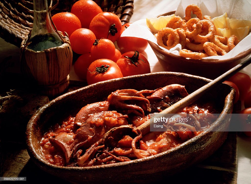 Deep-fried squid rings and squid in tomato sauce : Stock Photo
