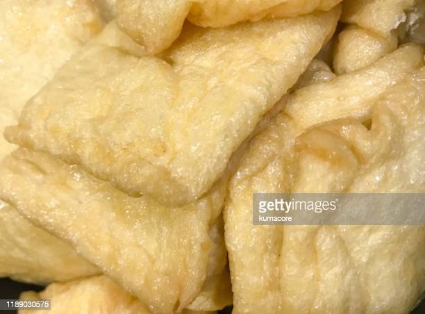 """deep-fried tofu,""""abura-age"""" - aburaage stock pictures, royalty-free photos & images"""