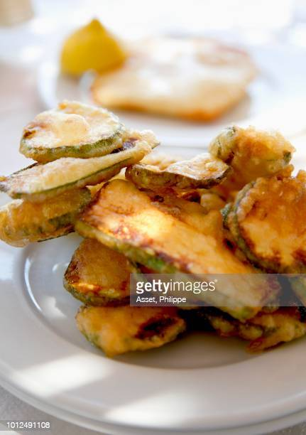 deep-fried zucchinis - breaded stock photos and pictures