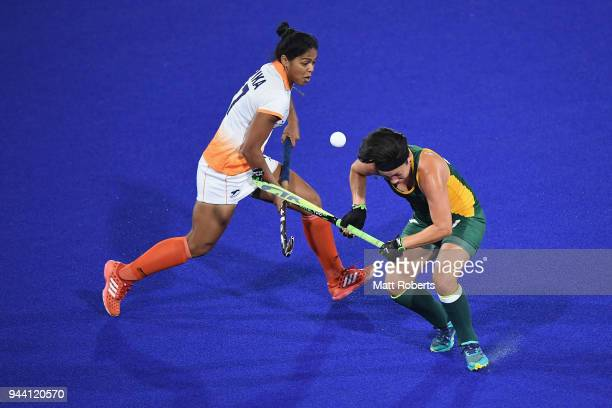 Deepika of India competes for the ball against Candice Manuel of South Africa during the Hockey Women's Pool A match between India and South Africa...