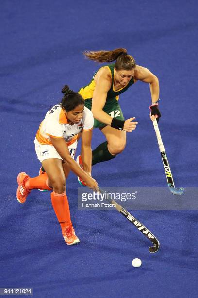 Deepika of India competes for the ball with Dirkie Chamberlain of South Africa during the Women's Pool A match between South Africa and India on day...
