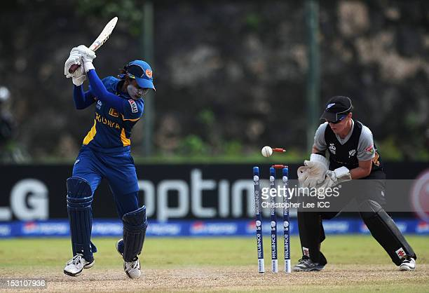 Deepika Rasangika of Sri Lanka is bowled out as Katey Martin of New Zealand stands by the stumps during the ICC Women's World Twenty20 2012 Group B...