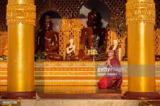 Deeply devoted monk in prayers