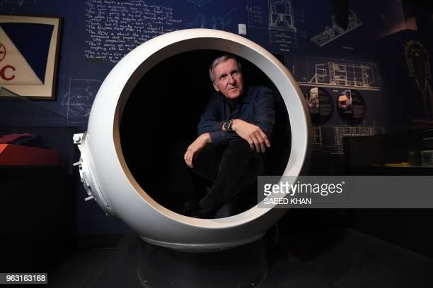 TOPSHOT Deepsea explorer and Academy Awardwinning filmmaker James Cameron sits in a scale model of the Deepsea Challenger's pilot chamber at an...