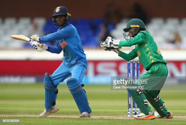 Deepti Sharma of India plays a shot in front of Sidra Nawaz of Pakistan during the ICC Women's World Cup match between India and Pakistan at The 3aaa...